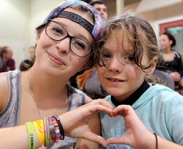 2 Campers make Heart Hands at Camp Can Do